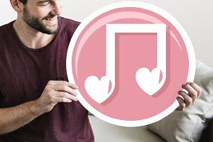 Cheerful man holding music note icon