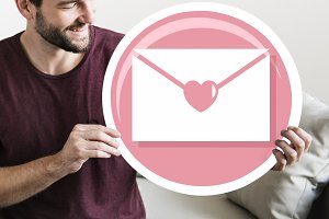 Cheerful man hold love letter icon