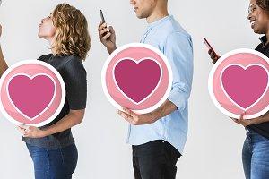 Diverse people holding valentine ico
