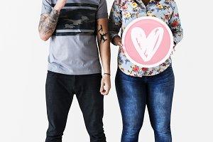 Couple holding valentine's icons