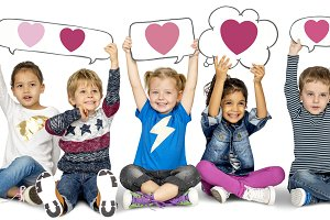 Kids hold bubbles with heart icons
