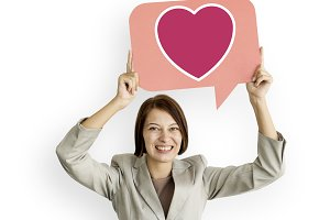 Businesswoman hold bubble heart icon