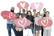 Diverse people holding heart icons