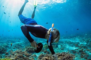 Young man snorkelling with camera