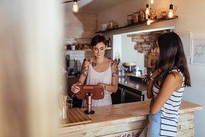 Woman entrepreneur taking orders