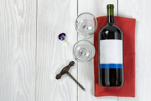 Wine and Glasses on white wood