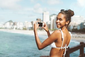 Black girl photographing cityscape