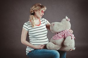 pregnant woman with soft toy