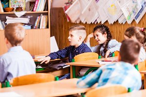 cute pupils are listening their teacher