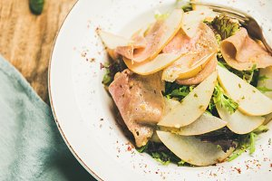 Summer salad with smoked turkey ham and pear, selective focus