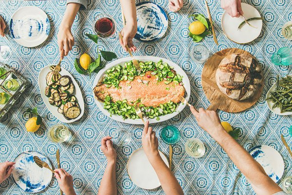 Food Stock Photos - Family or friends having seafood summer dinner