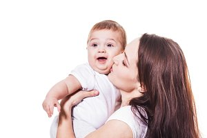 Mother kiss her baby isolated