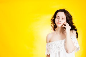 woman talking over yellow background