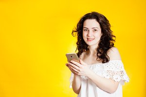 Portrait of a smiling woman with smartphone