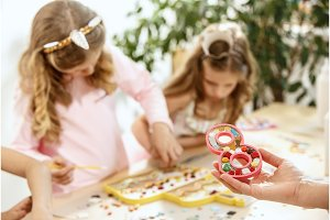 mosaic puzzle art for kids, children's creative game. two girls are playing mosaic