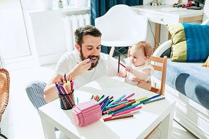 father and his baby daughter at home
