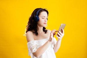Woman use wireless headphones