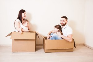Family unpacking cardboard boxes