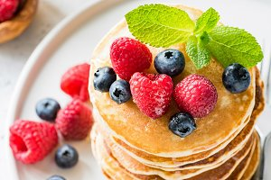 Pancakes with fresh berry and honey