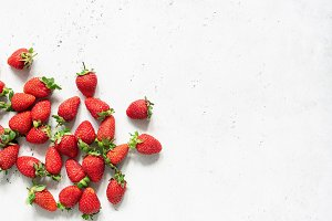 Fresh strawberries on grey concrete