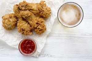 Fried chicken drumsticks with sauce