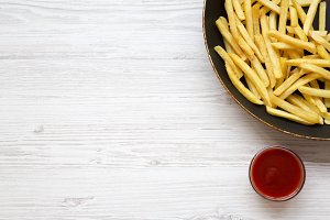 French fries in a frying pan with