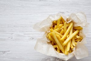 French fries over white wooden