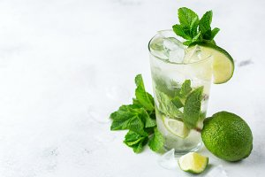 Classic alcohol cocktail mojito with rum, soda, lime and mint