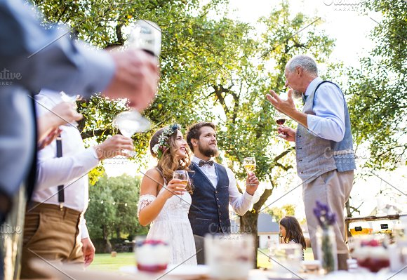 A Senior Man Making Speech At Wedding Reception Outside In The