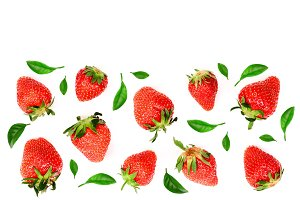 Strawberries decorated with leaves isolated on white background with copy space for your text. Top view. Flat lay