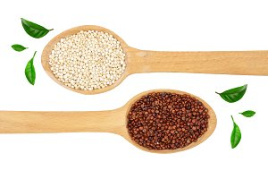 red and white quinoa seeds in wooden spoon isolated on white background. Top view