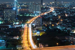 Roads and highways in Bangkok City at night in transportation concept, Thailand
