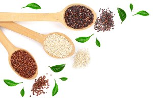 Black red white quinoa seeds in wooden spoon with leaves isolated on white background with copy space for your text