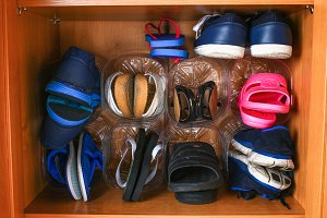 Shoe storage in the closet. Secondary use of plastic bottles. Saving space.