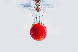 Red strawberry isolated on a white