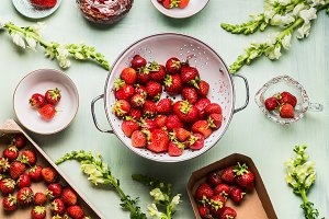 Strawberries in colander with jam