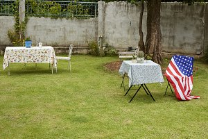 Field Chairs with American Flag in the Garden