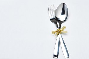 Fork and spoon with gold ribbon