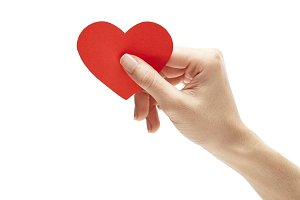 red paper heart in hand isolated on white