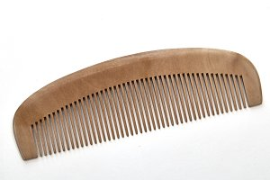 closeup brown wooden comb