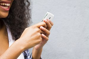 Afro girl with her mobile phone