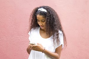 afro american girl with mobile phone