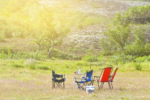 Camping site with camp-chairs and