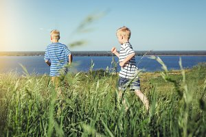 Two boys in striped t-shirts running out.