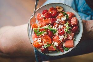 Man holding fresh healthy salad