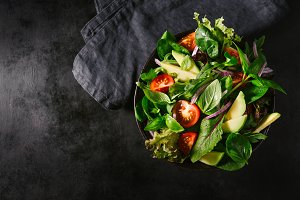 Detox tasty salad on dark table