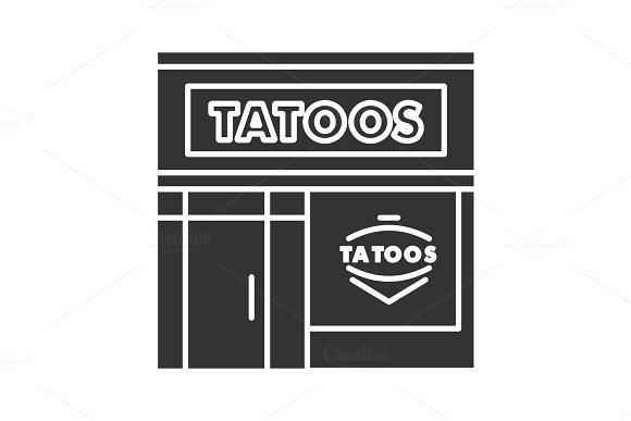 Tattoo studio facade glyph icon