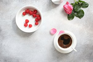 Cup of coffee and fresh raspberry.