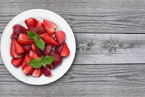 Juicy strawberrys on old wood background