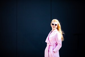The girl in a fashionable pink coat